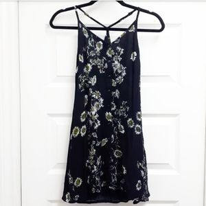 Black daisies floral print skater dress by OBEY.